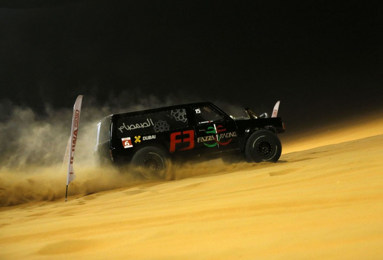 A driver takes part in a sand dune drag racing event on January 7, 2016, as part of the Liwa 2016 Moreeb Dune Festival in the Liwa desert, some 250 kilometers southwest of Abu Dhabi. (KARIM SAHIB/AFP/Getty Images)