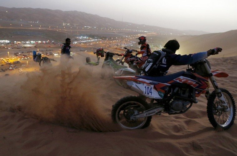 Bikers train before competing in a sand dune drag racing event on January 7, 2016, as part of the Liwa 2016 Moreeb Dune Festival in the Liwa desert, some 250 kilometres southwest of Abu Dhabi. (KARIM SAHIB/AFP/Getty Images)