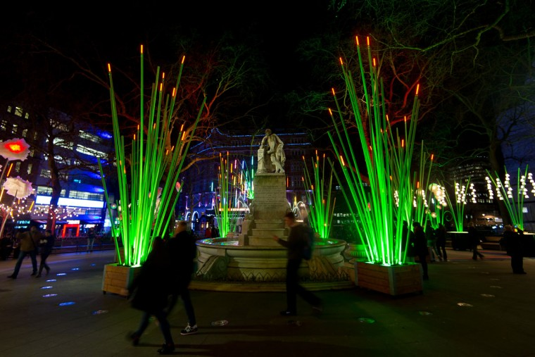 Visitors walk past the Garden of Light by artist TILT as it is exhibited in Leicester Square during the Lumiere London exhibition on January 13, 2016 in London, England. The first Lumiere exhibition in London is a free festival of light with exhibits placed in 30 locations across the capital. The event will run from January 14 to January 17. (Photo by Ben Pruchnie/Getty Images)