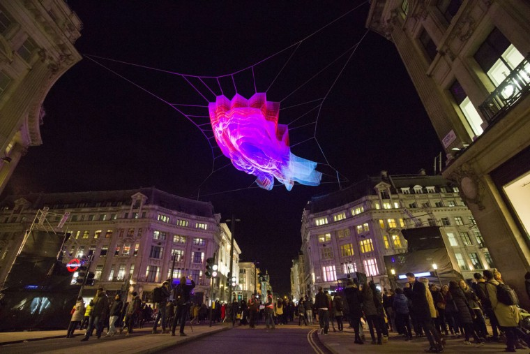 Spectators look at 1.8 London by US artist Janet Echelman on show as part of the lumiere light festival in London on January 14, 2016. London hosts a festival that brings together international light artists to create installations across the capital. (JUSTIN TALLIS/AFP/Getty Images)