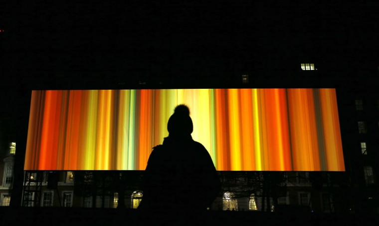 A woman looks at artwork called 'Spinning Night in Living Colour' by Elaine Buckholtz in London, Thursday, Jan. 14, 2016. Lumiere London is a festival of lights across 30 London locations, showing installations, projections and interactive pieces, the festival runs until Jan. 17. (AP Photo/Kirsty Wigglesworth)
