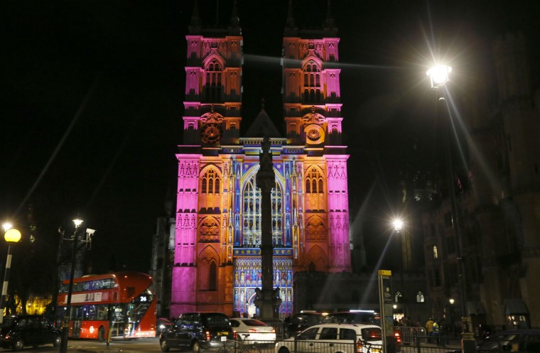 Traffic passes by Westminster Abbey as a display by artist Patrice Warrener called 'The Light of the Spirit' is seen on it, in London, Thursday, Jan. 14, 2016. Lumiere London is a festival of lights across 30 London locations, showing installations, projections and interactive pieces, the festival runs until Jan. 17 and is expected to attract thousands of visitors. (AP Photo/Kirsty Wigglesworth)