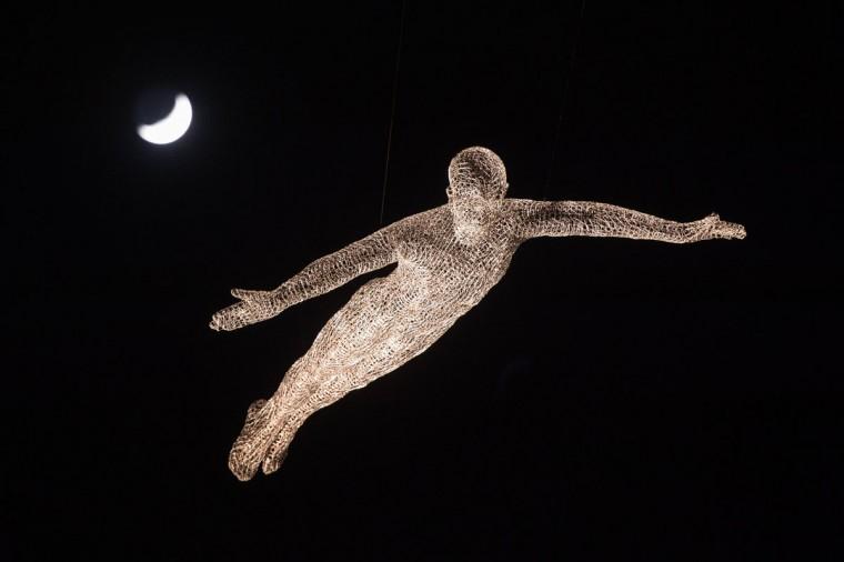 A figure from Les Voyageurs by Cedric Le Borgne in St James' Square, London, as part of the Lumiere London light festival, Thursday Jan. 14, 2016. (Dominic Lipinski/PA via AP)