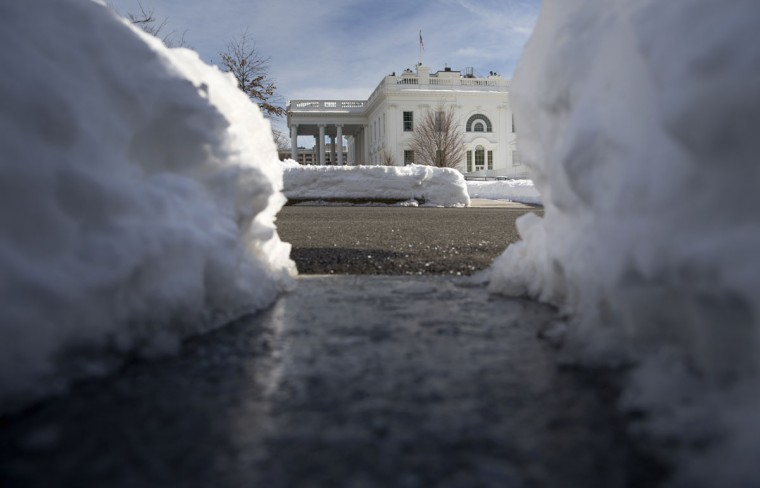 Paths and a driveway are cleared of snow on the White House grounds in Washington, Monday, Jan. 25, 2016. East Coast residents who made the most of a paralyzing weekend blizzard face fresh challenges as the workweek begins: slippery roads, spotty transit service mounds of snow, and closed schools and government offices.(AP Photo/Carolyn Kaster)