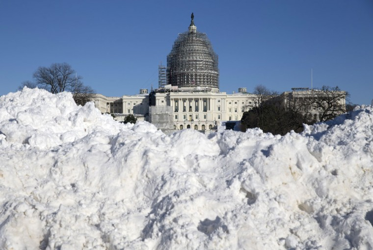 Snow is piled in front of the U.S. Capitol Building in Washington, Sunday, Jan. 24, 2016. Washington is digging out after a mammoth blizzard with hurricane-force winds and record-setting snowfall brought much of the East Coast to an icy standstill. (AP Photo/Carolyn Kaster)