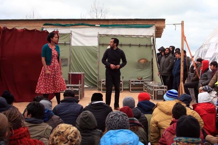 "Actors perform in Hamlet in the refugees camp of Calais, northern France, Wednesday Feb. 3, 2016. The Globe theater company took ""Hamlet"" to Calais , bringing one of Shakespeare's best-known plays to an audience that almost certainly would rather see it in his native country. The play is hosted by the Good Chance theater in the heart of the camp, one of numerous structures set up by volunteers to fill the void for its displaced residents. (AP Photo/Thibault Camus)"