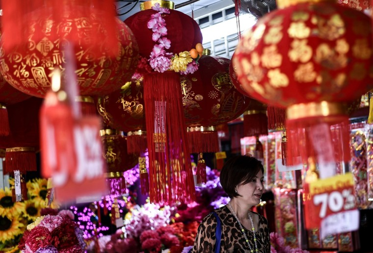An Ethnic Malaysian-Chinese woman checks out decorations at a shop in Kuala Lumpur's popular Chinatown on February 5, 2016 ahead of the Lunar New Year celebrations. The Lunar New Year will mark the start of the year of the monkey on February 8. (Manan Vatsyayana/AFP/Getty Images)