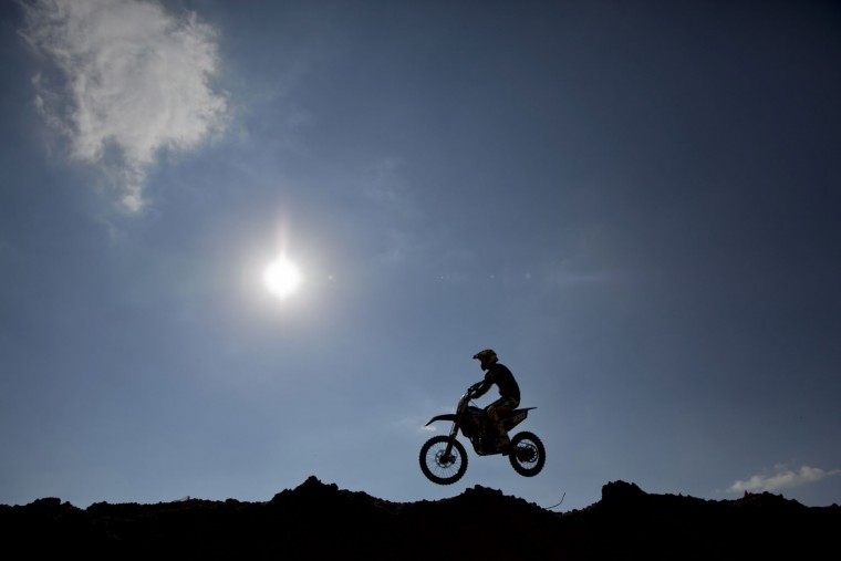 A rider jumps during a pre race for the inauguration of the first official Motocross track the MX Wingate cross country race track near Netanya, Israel, Thursday, Feb. 11, 2016. (AP Photo/Ariel Schalit)