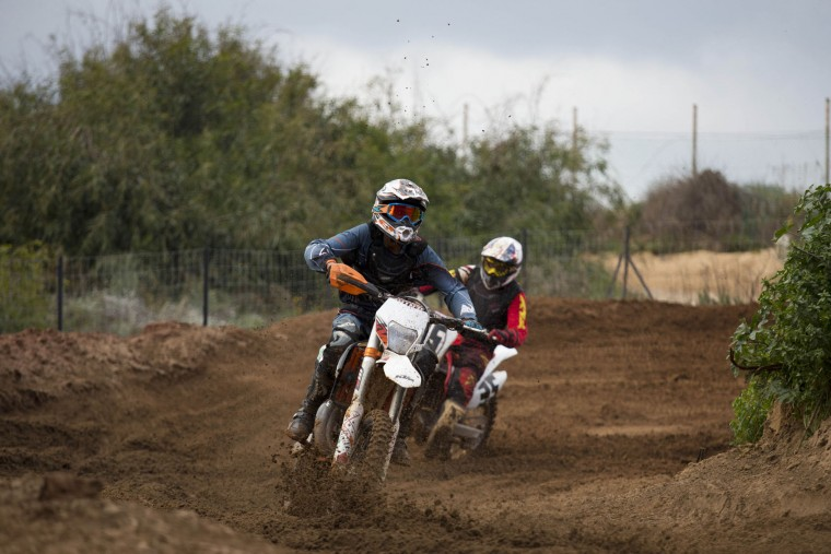 Riders race during a pre race for the inauguration of the first official Motocross track the MX Wingate cross country race track near Netanya, Israel, Thursday, Feb. 11, 2016. (AP Photo/Ariel Schalit)