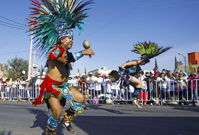 Mexican natives perform before the arrival of Pope Francis in Ecatepec --a rough, crime-plagued Mexico City suburb-- where he is to celebrate an open-air mass, on February 14, 2016. Pope Francis has chosen to visit some of Mexico's most troubled regions during his five-day trip to the world's second most populous Catholic country. (Pedro Pardo/AFP/Getty Images)