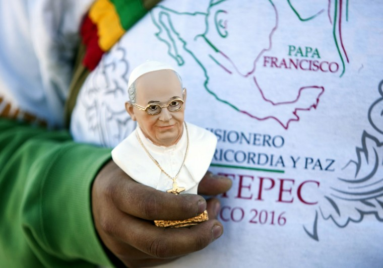 Catholic faithful wait for the arrival of Pope Francis in Ecatepec --a rough, crime-plagued Mexico City suburb-- where he is to celebrate an open-air mass, on February 14, 2016. Pope Francis has chosen to visit some of Mexico's most troubled regions during his five-day trip to the world's second most populous Catholic country. (Julio Cesar Aguilar/AFP/Getty Images)