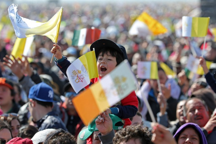 A child waves a Vatican flag as he waits for the arrival of Pope Francis in Ecatepec, Mexico, Sunday, Feb. 14, 2016. Pope Francis will give a Mass at an outdoor field in the capital's suburb of Ecatepec to a crowd of hundreds of thousands of pilgrims. It is to be his biggest event during his trip to Mexico. (AP Photo/Dario Lopez-Mills)
