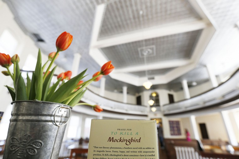 A bouquet of flowers are displayed in honor of Harper Lee at the Monroe County Heritage Museum old courthouse, Friday, Feb. 19, 2016, in Monroeville, Ala. Lee, the elusive author, died Friday, according to her publisher Harper Collins. She was 89. (AP Photo/Brynn Anderson)