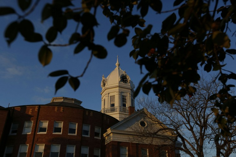 """The clock tower of the old courthouse at the Monroe County Heritage Museum is seen, Friday, Feb. 19, 2016, in Monroeville, Ala. Harper Lee, the elusive author of best-seller """"To Kill a Mockingbird,"""" died Friday, Feb. 19, 2016, according to her publisher Harper Collins. She was 89. (AP Photo/Brynn Anderson)"""
