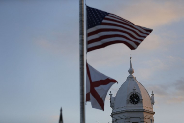 "The clock tower of the old courthouse is surrounded by the American flag and the Alabama State flag at the Monroe County Heritage Museum is seen, Friday, Feb. 19, 2016, in Monroeville, Ala. Harper Lee, the elusive author of best-seller ""To Kill a Mockingbird,"" died Friday, Feb. 19, 2016, according to her publisher Harper Collins. She was 89. (AP Photo/Brynn Anderson)"