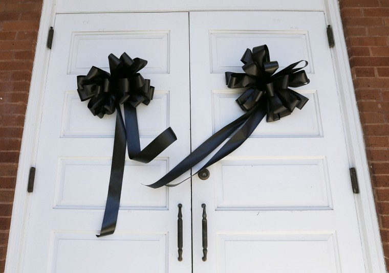 "Black ribbon is placed on the front doors of the Monroe County Heritage Museum in memorial of Harper Lee, Friday, Feb. 19, 2016, in Monroeville, Ala. Lee, the elusive author of ""To Kill a Mockingbird,"" died Friday, Feb. 19, 2016, according to her publisher Harper Collins. She was 89. (AP Photo/Brynn Anderson)"