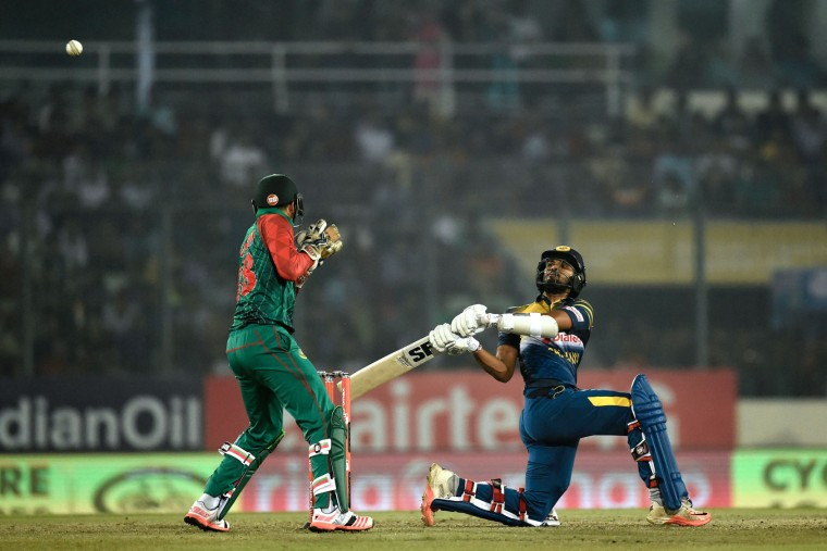 Sri Lanka's Dinesh Chandimal (R) plays a shot next to Bangladesh's wicketkeeper Nurul Hasan (L) during the Asia Cup T20 cricket tournament match between Bangladesh and Sri Lankaat at the Sher-e-Bangla National Cricket Stadium in Dhaka on February 28, 2016. (Munir uz Zaman/AFP/Getty Images)