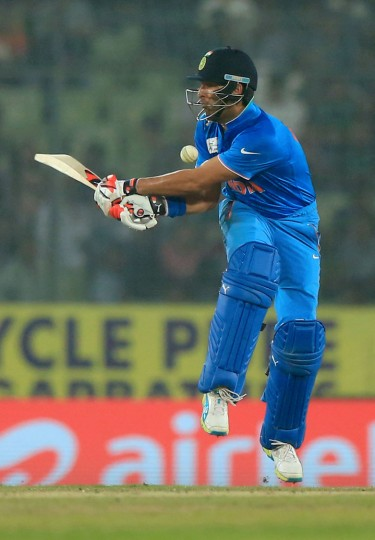India's Yuvraj Singh plays a shot during the Asia Cup T20 cricket tournament match between India and Pakistan at the Sher-e-Bangla National Cricket Stadium in Dhaka on February 27, 2016. India trounced bitter rivals Pakistan by five wickets in a one-sided affair at the Asia Cup Twenty20 tournament. (STR/AFP/Getty Images)
