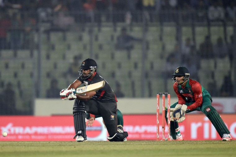 United Arab Emirates cricketer Muhammad Usman (L) plays a shot as the Bangladesh wicketkeeper Nurul Hasan (R) looks on during the match between Bangladesh and United Arab Emirates at the Asia Cup T20 (Twenty20)cricket tournament at the Sher-e-Bangla National Cricket Stadium in Dhaka on February 26, 2016. (Munir uz Zaman/AFP/Getty Images)