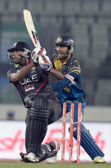United Arab Emirates captain Amjad Javed plays a shot as Sri Lanka's wicketkeeper Dinesh Chandimal looks on during the match between Sri Lanka and United Arab Emirates at the Asia Cup T20 cricket tournament at the Sher-e-Bangla National Cricket Stadium in Dhaka on February 25, 2016. (Munir uz Zaman/AFP/Getty Images)