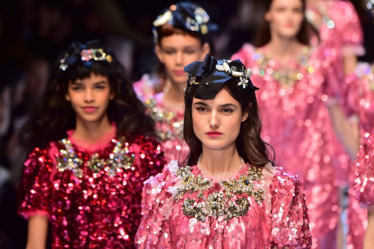 Models present creations for fashion house Dolce Gabbana as part of the Women Autumn / Winter 2016 Milan Fashion Week on February 28, 2016. (AFP Photo/Giuseppe Cacace)