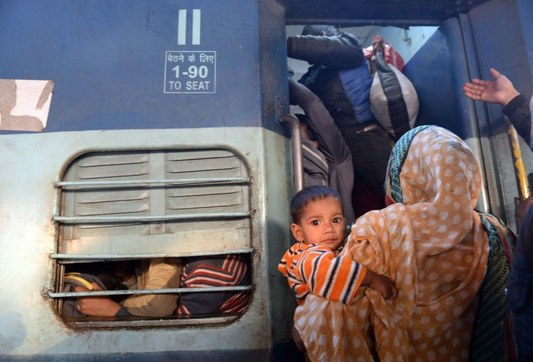 Indian passengers try and enter the packed general wagon of The Simanchal Express at Anand Vihar Railway Station in New Delhi on February 25, 2016. Indian Railways Minister Suresh Prabhu is set to announce the Indian Railways Budget in the country's parliament. (PRAKASH SINGH/AFP/Getty Images)