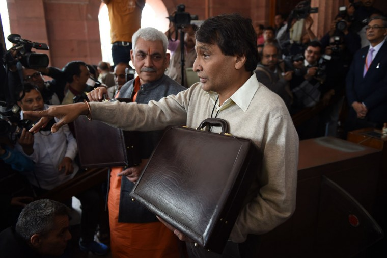 India's Railways Minister Suresh Prabhu poses with Minister of State Manoj Sinha (center left) as he enters Parliament House in New Delhi on February 25, 2016, ahead of releasing The Railways Budget. (MONEY SHARMA/AFP/Getty Images)