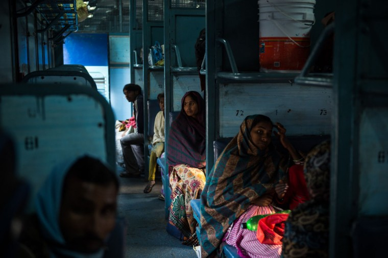 An Indian woman sits inside a carriage as she waits for a train to leave Hazrat Nizamuddin railway station in New Delhi on February 25,2016. Indian Railway minister Suresh Prabhu is set to announce the Indian Railways Budget on February 25. (Chandan Khanna/AFP/Getty Images)