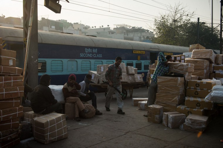 Indian workers sit beside the cargo lot at Hazrat Nizamuddin railway station in New Delhi on February 25,2016. Indian Railway minister Suresh Prabhu is set to announce the Indian Railways Budget on February 25. (Chandan Khanna/AFP/Getty Images)