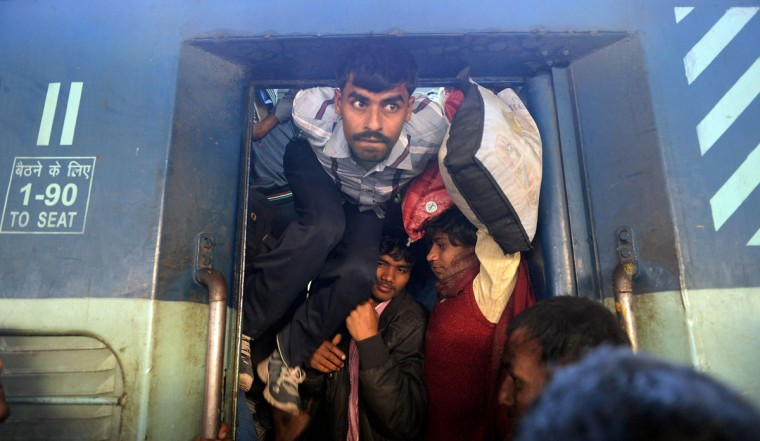 Indian passengers squeeze into the packed general wagon of The Simanchal Express at Anand Vihar Railway Station in New Delhi on February 25, 2016. Indian Railways Minister Suresh Prabhu is set to announce the Indian Railways Budget in the country's parliament. (PRAKASH SINGH/AFP/Getty Images)