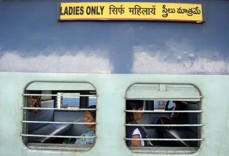 Indian passengers sit in a 'Ladies Only 'carriage as they wait for a train to depart from a platform at Secunderabad Railway Station in Hyderabad on February 25, 2016, as Indian Railways Minister Suresh Prabhu presents The Railway Budget at Parliament House in New Delhi. (NOAH SEELAM/AFP/Getty Images)