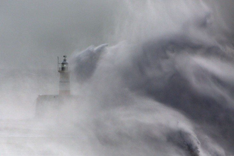 Waves hit a lighthouse on the harbor wall on February 8, 2016 in Newhaven, East Sussex. Storm Imogen is the ninth named storm to hit the UK this season. This year's storms are being named in an effort by the Met Office and Met Eireann to increase public awareness and safety. They were named by public ballot and there are no names for the letters Q, U, X, Y and Z. (Photo by Carl Court/Getty Images)