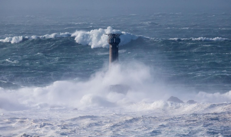 Waves crash over the Longships Lighthouse just off Land's End on February 8, 2016 in Cornwall, England. Parts of the UK are currently being battered by Storm Imogen, the ninth named storm to hit the UK this season. Thousands of homes have been left without power and commuters hit by road and rail chaos as Storm Imogen batters the South with gale force winds and torrential rain. (Photo by Matt Cardy/Getty Images)