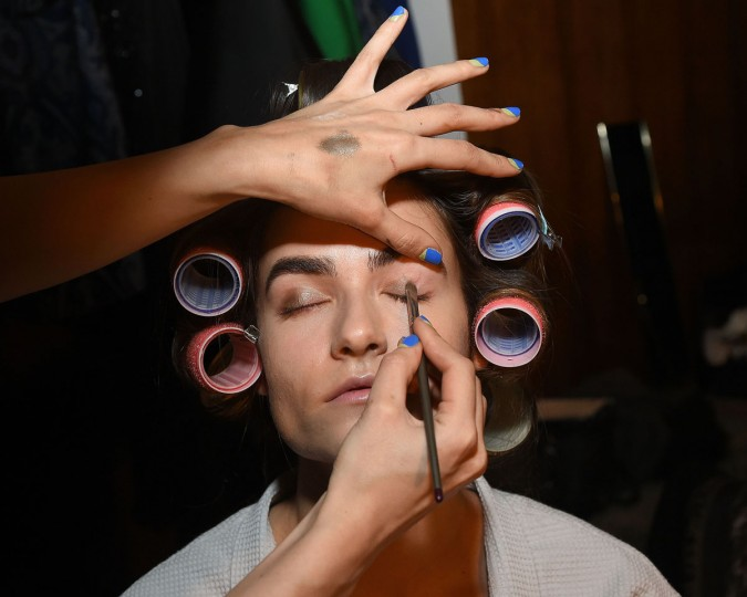 A model prepares backstage at the Elizabeth Kennedy presentation during Fall 2016 New York Fashion Week at The Four Seasons Restaurant on February 10, 2016 in New York City. (Photo by Ben Gabbe/Getty Images)