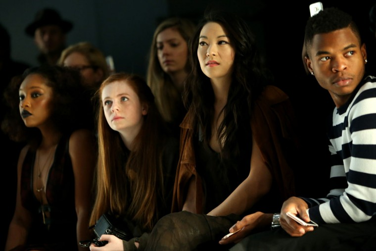 (L-R) Actresses Christina Jackson, Clare Foley, and Arden Cho attend the Nicholas K Fall 2016 fashion show during New York Fashion Week: The Shows at The Dock, Skylight at Moynihan Station on February 11, 2016 in New York City. (Photo by Monica Schipper/Getty Images for NYFW: The Shows)