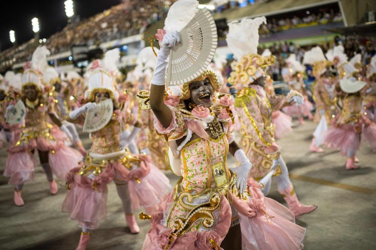 Revelers of Beija Flor samba school perform during the first night of the carnival parade at the Sambadrome in Rio de Janeiro, Brazil, on february 08, 2016. (AFP Photo/Christophe )