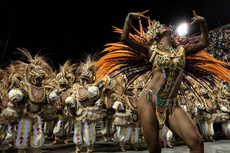 Revelers of Unidos da Tijuca samba school perform during the first night of the carnival parade at Sambadrome in Rio de Janeiro, Brazil on February 8, 2016. (AFP Photo/Yasuyoshi )