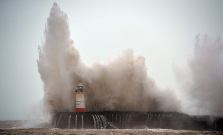 Waves crash over Newhaven Lighthouse on the south coast of England on February 8, 2016, as the latest storm hits the country. Heavy winds buffeted Europe's northwestern flank on Monday, forcing road closures and disrupting rail and ferry services in southern England and prompting high wave alerts in France's Brittany region. Gales and heavy rain with wind speeds of nearly 100 miles per hour (155 kilometres per hour) battered southern England and Wales, with flood warnings issued in more than 50 areas. (GLYN KIRK/AFP/Getty Images)