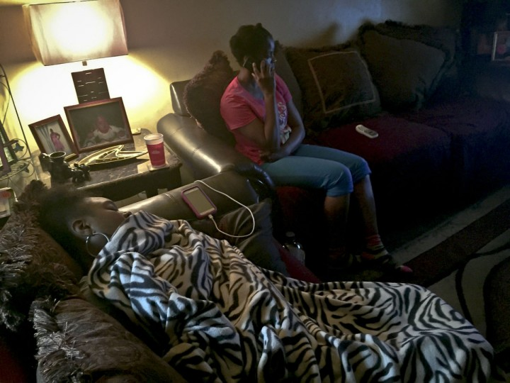 """In this Tuesday, June 23, 2015 photo, Candie Hailey, right, visits a friend living nearby to use a phone after a confrontation with a resident at a shelter where she was staying in New York. Frustrated by what she perceives as the slow pace of efforts to help her live a """"normal"""" life after her release from Rikers Island jail, Hailey threatens to leave the city for New Hampshire where she believes she would have a better start, for housing and the means to regain custody of her children. (AP Photo/Bebeto Matthews)"""