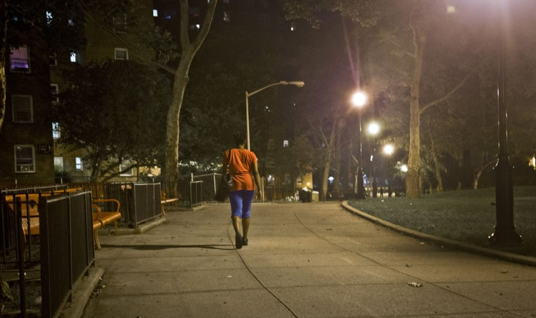 "In this Tuesday, June 23, 2015 photo, refusing to return to a shelter following a confrontation with another resident, Candie Hailey walks through the park area of the housing community where she once lived - uncertain where she would spend the night - in New York. ""I won't sleep until around 5 [a.m.] anyway,"" said Hailey, explaining that she has trouble sleeping through the night and formed a habit of staying awake at Rikers Island jail out of fear that she would be abused by guards at night. (AP Photo/Bebeto Matthews)"