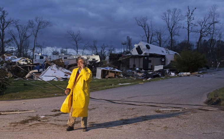 Director of Emergency Operations for St. James Parish Blaise Gravois talks on the phone at Sugar Hill RV Park following a storm in Convent, La., Wednesday, Feb. 24, 2016. Tornadoes and severe weather ripped through the Gulf Coast on Tuesday, mangling trailers at an RV park and ripping off roofs from buildings in Louisiana and Mississippi, authorities said. (AP Photo/Max Becherer)