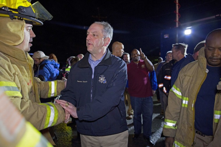 "Louisiana Governor John Bel Edwards thanks first responders after he toured the remains of trailers and vehicles after a suspected tornado hit the Sugar Hill RV Park in Convent, La., Tuesday, Feb. 23, 2016. Edwards described the scene as a ""jumbled mess."" ""We all need to be prayerful and mindful and take those tornado warnings when we see them very seriously,"" Edwards said. (AP Photo/Max Becherer)"