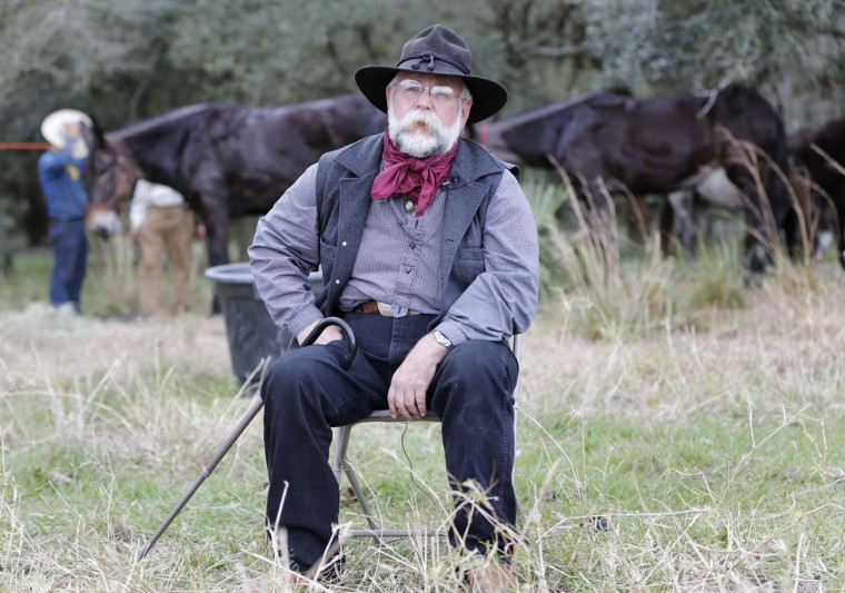In this Tuesday, Jan. 26, 2016 photo, Doyle Conner Jr., chairman of the Great Florida Cattle Drive 2016, sits in a field before an interview in Kenansville, Fla. ìWe try to remember the way it used to be and draw attention that the cattle industry was the first industry in America,î said Conner. (AP Photo/Wilfredo Lee)