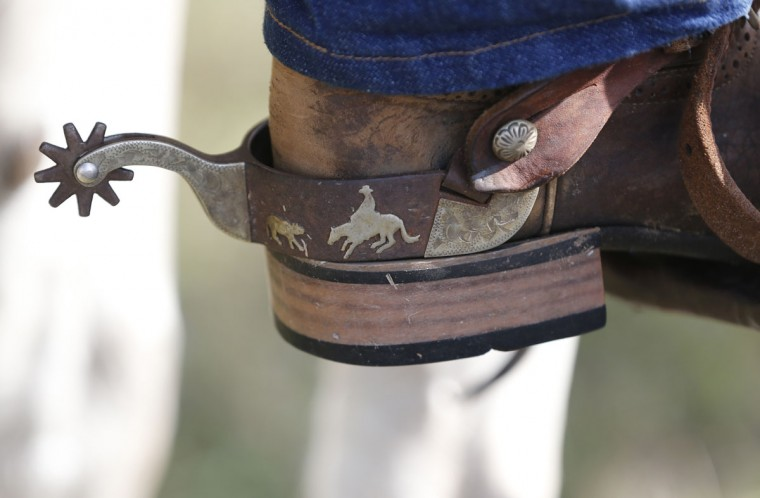 In this, Tuesday, Jan. 26, 2016 photo, a close-up of Kendall Snyder's spurs during the second day of the Great Florida Cattle Drive 2016, in Kenansville, Fla. (AP Photo/Wilfredo Lee)