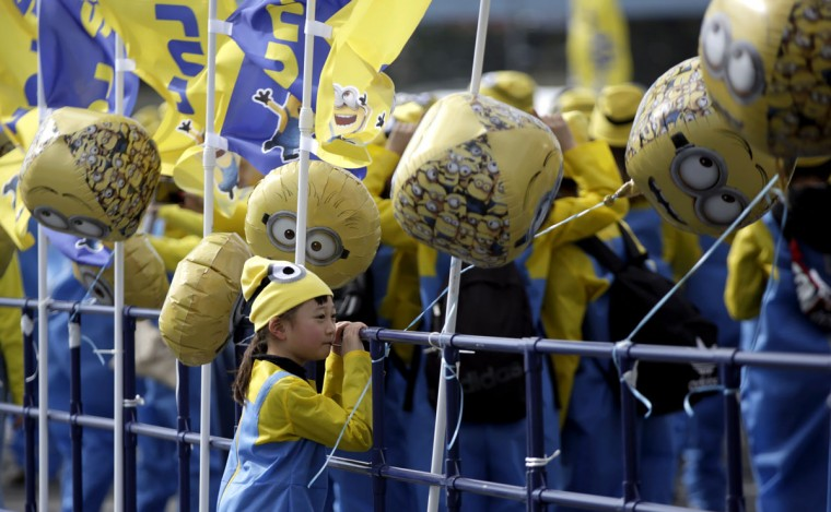 "One of young participants dressed as ""minions"" looks at others as they assemble at the start of the Minions Run charity event in Tokyo, Saturday, Feb. 13, 2016. (AP Photo/Eugene Hoshiko)"
