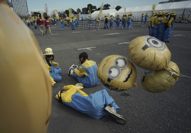 "Participants dressed as ""minions"" rest after the Minions Run charity event in Tokyo, Saturday, Feb. 13, 2016. Some 10,000 runners enjoyed one kilometer run for the charities of children. (AP Photo/Eugene Hoshiko)"