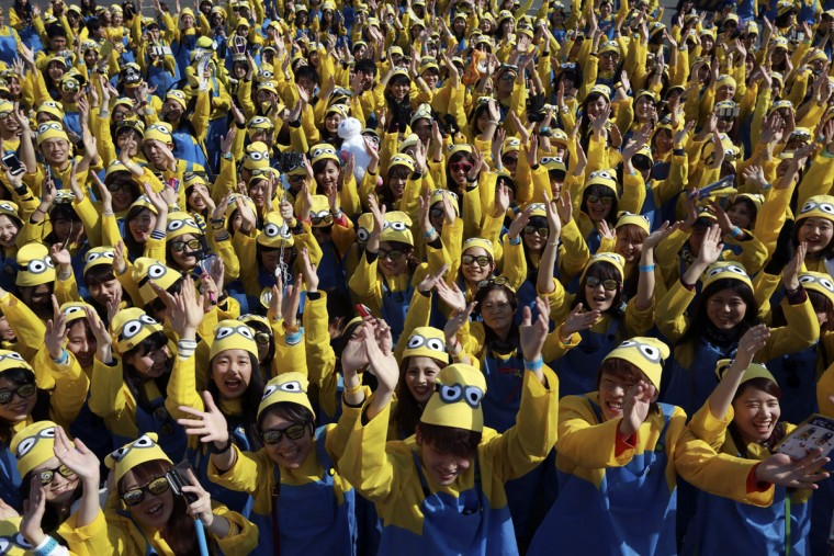 "Participants dressed as ""minions"" assemble at the start of the Minions Run charity event in Tokyo, Saturday, Feb. 13, 2016. (AP Photo/Eugene Hoshiko)"