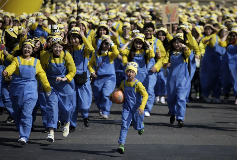 "Participants dressed as ""minions"" compete during the Minions Run charity event in Tokyo, Saturday, Feb. 13, 2016. Some 10,000 runners enjoyed one kilometer run for the charities of children. (AP Photo/Eugene Hoshiko)"