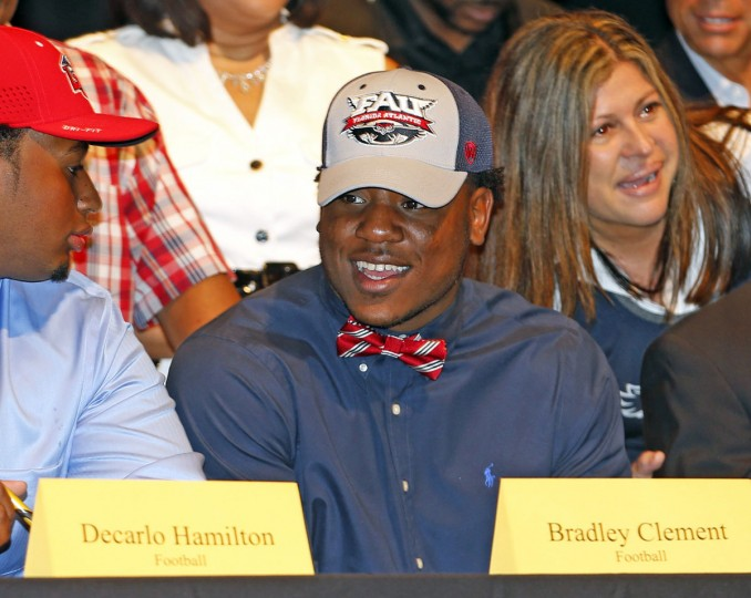American Heritage football player Bradley Clement commits to FAU during a national signing day event at American Heritage High School, Wednesday, Feb. 3, 2016, in Plantation, Fla. (Charles Trainor Jr./The Miami Herald via AP)