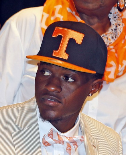 American Heritage football player Brandon Johnson commits to the Tennessee during a national signing day event at American Heritage High School, Wednesday, Feb. 3, 2016, in Plantation, Fla. (Charles Trainor Jr./The Miami Herald via AP)